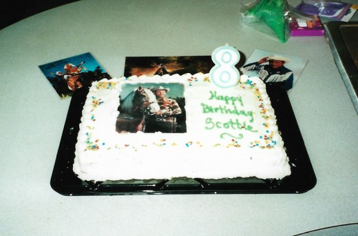 I made a Western birthday cake by laminating a picture of Roy Rogers and Trigger that I found on the internet. After laying it on the cake, I bordered it with icing.