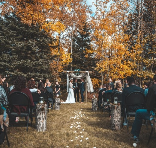 An outdoor wedding can be a great way to save money while still having a beautiful wedding. Consider a local state park or nature preserve.