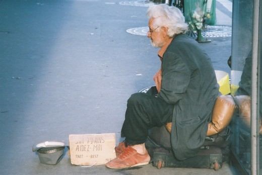 "This was taken in Paris, France. The sign reads: ""I am 79 years old. Help me."""