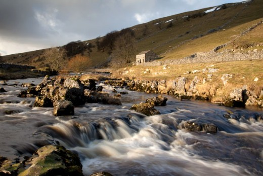 A characteristic Dales stone barn keeps watch over the river - some have seen conversion to homes, although stringent planning laws in the Dales National Park ensure nothing untoward is done, and keeps to the character of the area