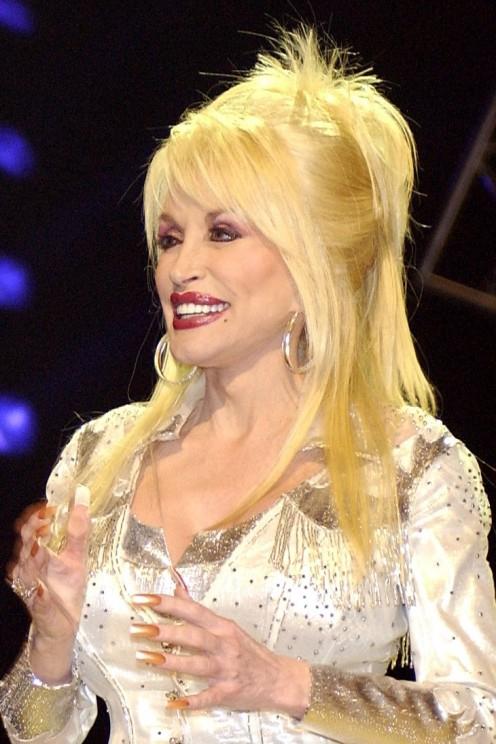 Dolly Parton is proud of her boobs and puts them to good use.