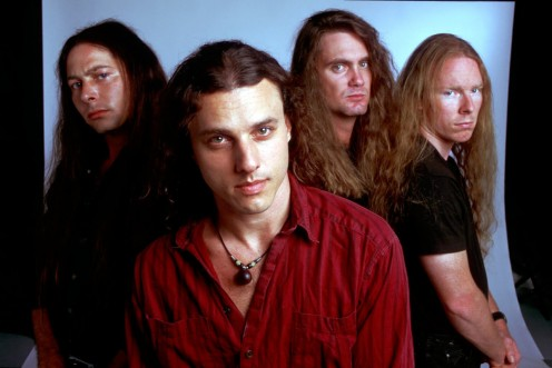 Chuck Schuldiner (1967-2001) is pictured at the center of the photo.