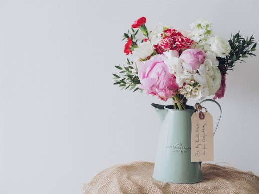 Use a water jug instead of a vase for your flower arrangement.