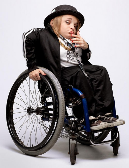 42-inch tall Kalyn Heffernan was born with brittle bone disease. She is the emcee and public face of Denver's Wheelchair Sports Camp, a renowned hip-hop group.