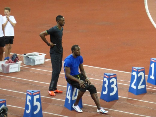 Usain Bolt, coached by Glen Mills (not pictured) viewed injuries as part of training