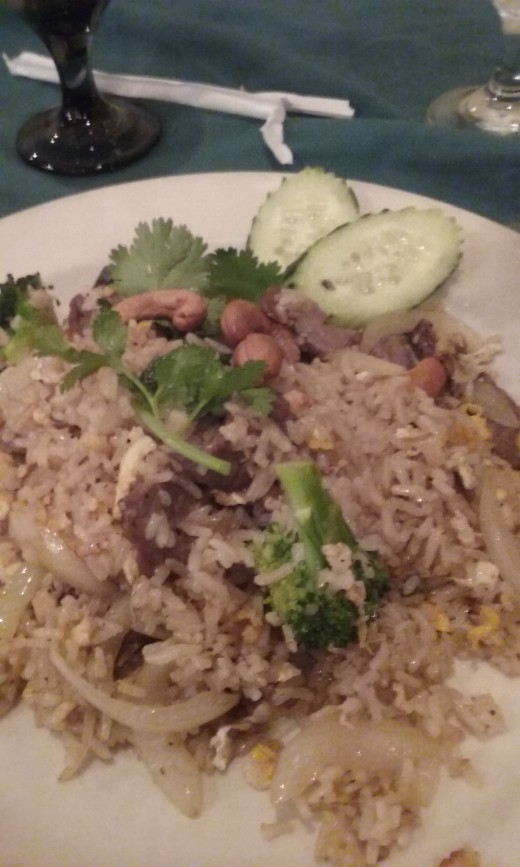 Beef fried rice from Taste of Thai Restaurant in Greensboro, NC. This is a delicious tasting beef fried rice that is garnished with cucumbers and cashew nuts.