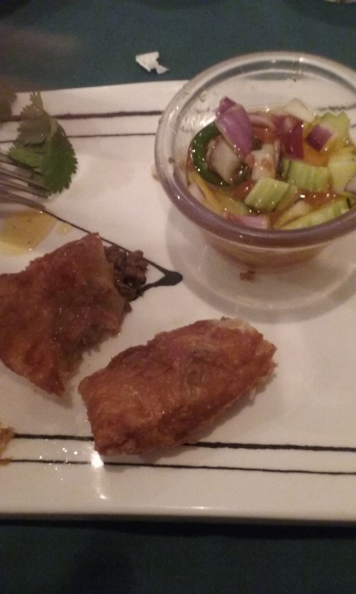 for an appetizer at Taste of Thai restaurant, a delicious puff pastry containing ground lamb meat. A refreshing and tart sauce containing diced cucumber accompanies the appetizer.