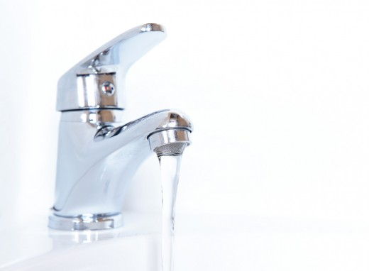 Running cold tap water on your wrists will reduce body temperature.