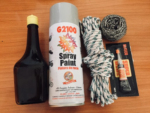 A Glass Bottle, Shoelace String, Spray Paint (Color Of Your Choice),Super Glue, Stainless Steel Scrubber