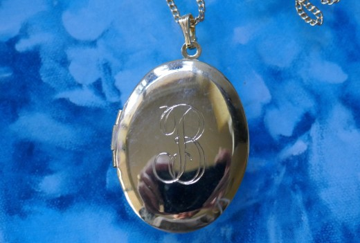 My gold locket inscribed with B.