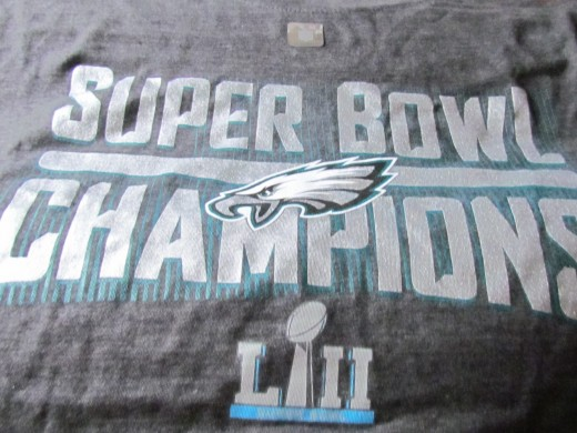 A t-shirt with the logo for the Super Bowl Champions Philadelphia Eagles win for 2018, 52nd game.