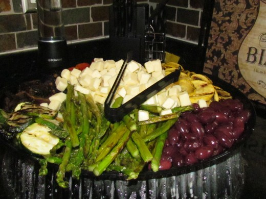 An outstanding array of grilled vegetables such as asparagus, olives, peppers and cheese. It was delicious.