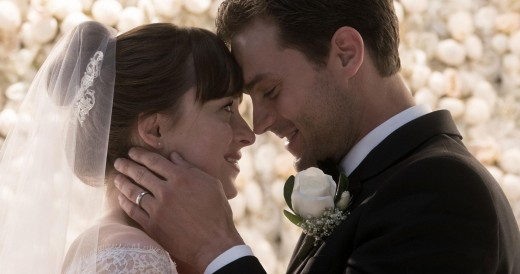 Anastasia Grey (Dakota Johnson) and Christian Grey (Jamie Dornan) at their ceremony.