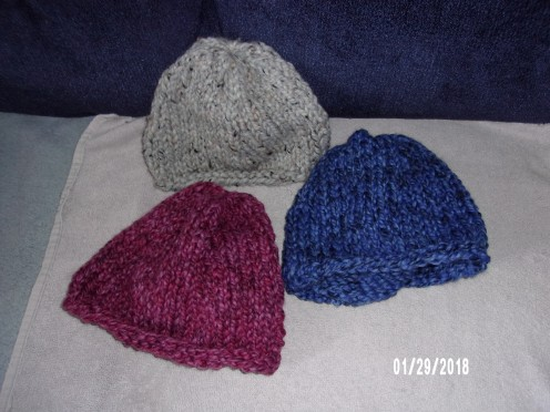 Each hat made with part of a skein of Lion Brand Wool Ease Thick & Quick yarn. Grey Marble, Strawberry, Acai yarn colors.