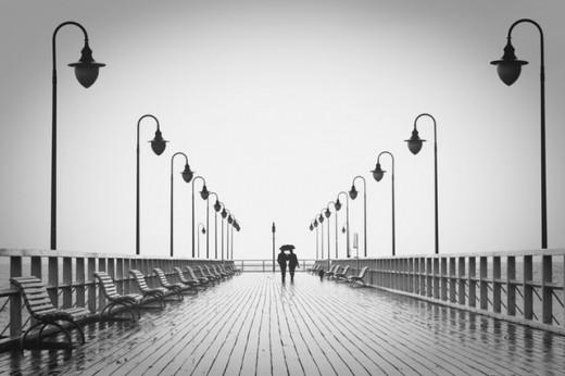 A Couple Walking Along a Pier