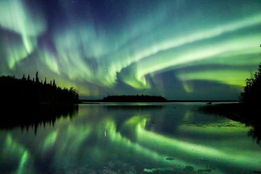 Aurora fill the night sky in northern Ontario.