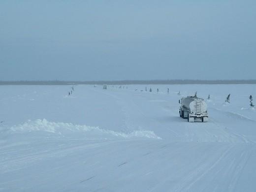 A truck crosses the Albany River on the winter road from Moosonee to Attawapiskat.