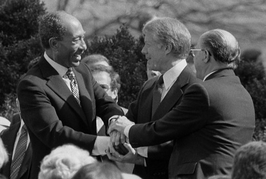 """""""Photograph shows President Jimmy Carter shaking hands with Egyptian President Anwar Sadat and Israeli Prime Minister Menachem Begin at the signing of the Egyptian-Israeli Peace Treaty on the grounds of the White House."""""""