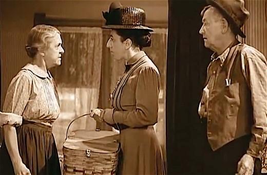Clara Blandick, Margaret Hamilton, and Charles Grapewin.