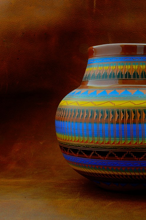 Native American pottery makes a colorful addition to a neutral room.