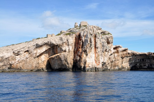 Sailing through Kornati archipelago will give away many beautiful sights. This is island Mana. The Greek village was built on the top of the hill for the film 'As the Sea Rages' (1959).