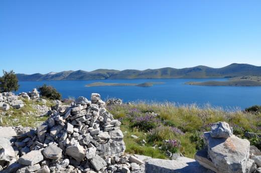 Island Kornat at the back - the biggest island of Kornati National Park.