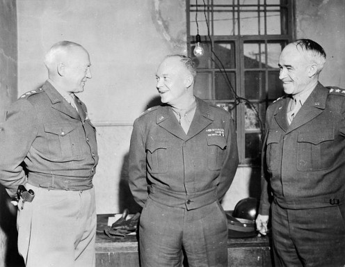 Gen. Dwight D Eisenhower, Supreme Commander-in-Chief, Allied Expeditionary Forces, Lieut. Gen. Omar N Bradley, Commanding Gen. of the 12th US Army Group, and Lieut. Gen. George S Patton, Commanding Gen. of the 3rd US Army
