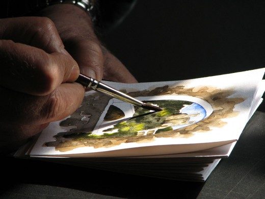 This photo draws you into the process of creating a watercolor. You start to wonder who the artist is, where they are, and what they are painting.