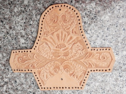 The hand carved leather coin purse after the leather carving stage.