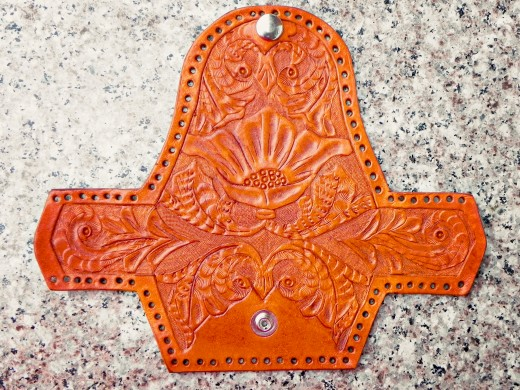 The entire hand carved leather coin purse after the dyeing stage.