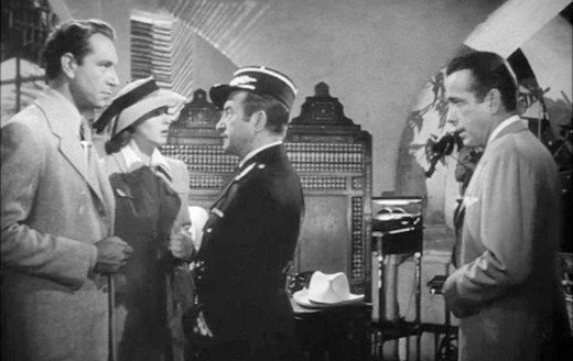 Left to Right Victor (Paul Henreid), Ilsa (Ingrid Bergman), Captain Renault (Claude Rains), and Rick (Humphrey Bogart)