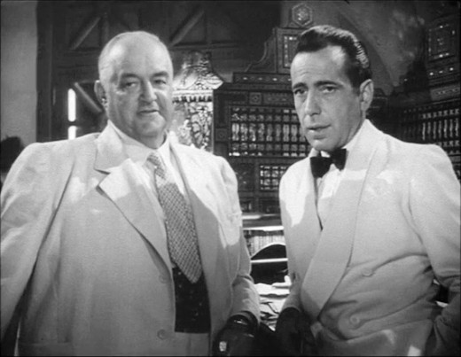 Ferrari (Sydney Greenstreet) and Rick (Humphrey Bogart)