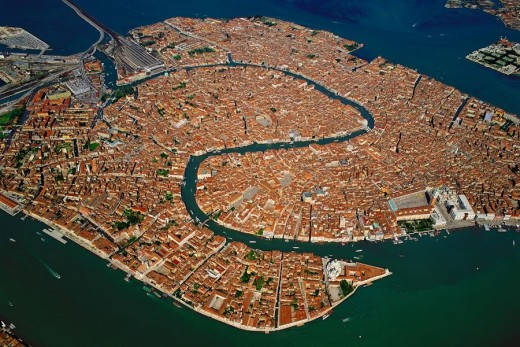 An aerial view of Venice's Old Town showing the Grand Canal snaking through the middle.