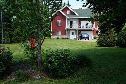 Two guest bedrooms & a full bath on the bottom floor. Main living quarters are on the 2nd floor. Bedroom, bathroom, Kitchen, living room, dining room, entrance to the outside deck The top window is a game room, pull out sofa for another guest.