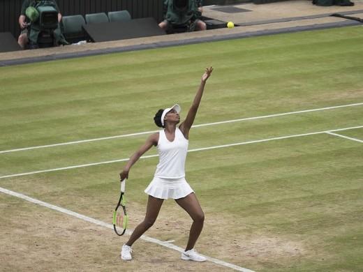 Venus Williams serves a tie-breaker at Wimbledon 2017.