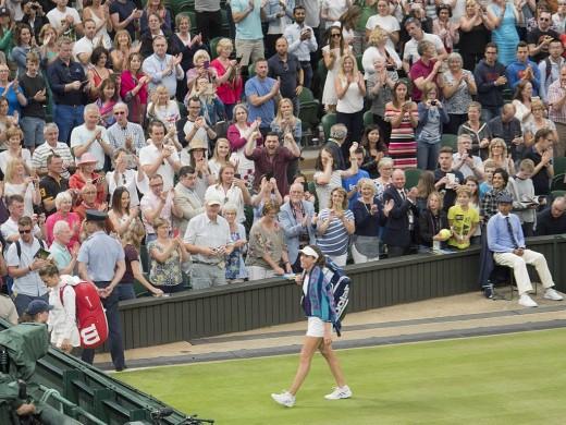 Johanna Konta acknowledges the crowd with a winning smile, Wimbledon 2017.