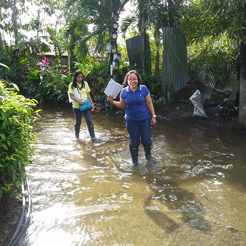 Smiling although assigned to do fieldwork at flooded place
