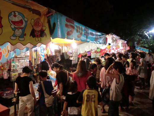 People enjoying the food and games in the summer night