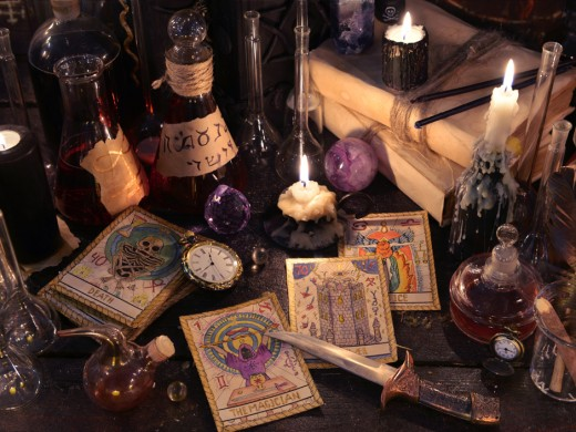Picture of witchcraft materials like tarot cards and candles