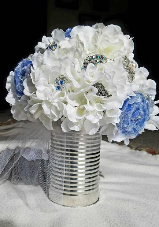 Bridal Bouquet with brooches from secondhand shops; reused coffee can for the holder.