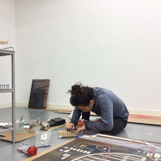 Image: Soojin Hong making her own material for her paintings out of pins and screws in ACME Studios in London.
