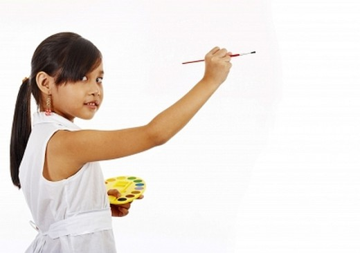 Little girl painting.  Children need enrichment classes.