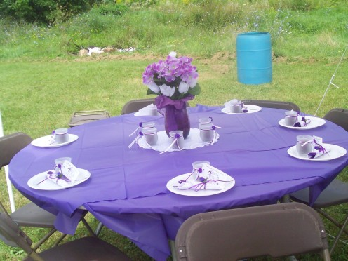 Table center-pieces.  I bought purple colored vases online and made simple flower arrangements with flowers purchased at the Dollar Store.