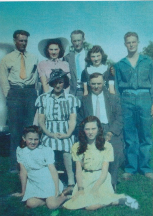 My Father's Family; From left to right standing:  dad, Aunt Marie, Uncle Augie, Aunt Laura and Uncle Dick; Seated are grandma and grandpa; Sitting in front left to right are Aunt Florence and Aunt Helen.  Picture taken about 1938