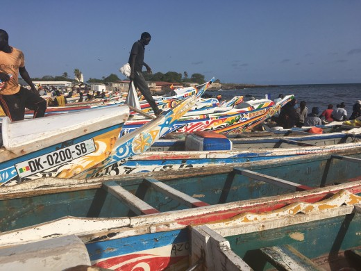 Senegalese fishers and their boats