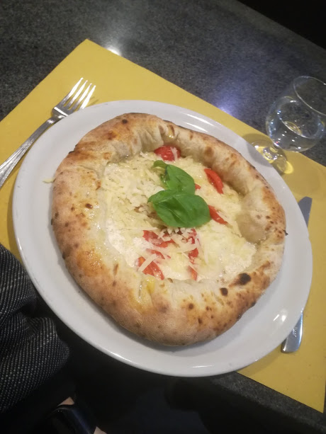 A Neapolitan style pizza with addition of parmesan cheese and mozzarella in the crust.