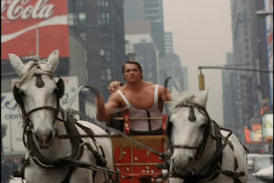 One of the few highlights - Hercules riding through Times Square on a chariot. Look how thrilled Arnold is!