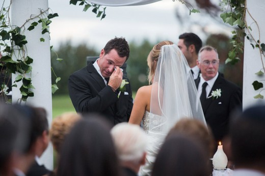 An emotional groom after sharing vows.
