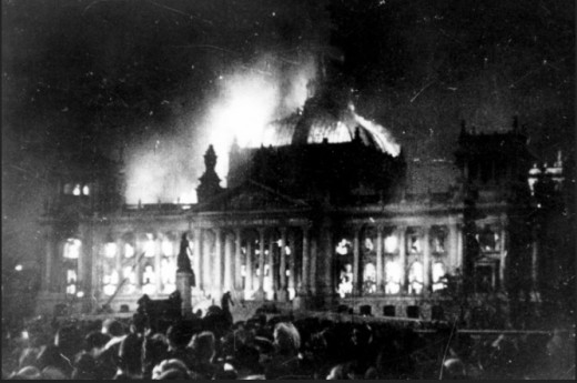 Here the German Parliament building (der Reichstag) is set ablaze, most likely, by the Nazi party in an attempt to make all other political entities illegal, thus denying the right of peaceable assembly of the people.