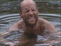 Michael Skupin desperately cooling his burning hands in Survivor: Australia after his terrible accident.